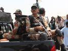 Возросло число жертв в результате нападения на отель в Пакистане