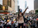 Аэропорты Гонконга усилили безопасность в связи с митингами