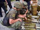 Три воевавших в Донбассе добровольческих батальона сдали оружие украинским полицейским