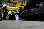 Workers install crawler bands at an excavator production line at the Volvo Construction Equipment.