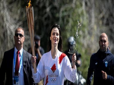 Olympic Flame Passed to the Organizing Committee of Games 2020 in Tokyo