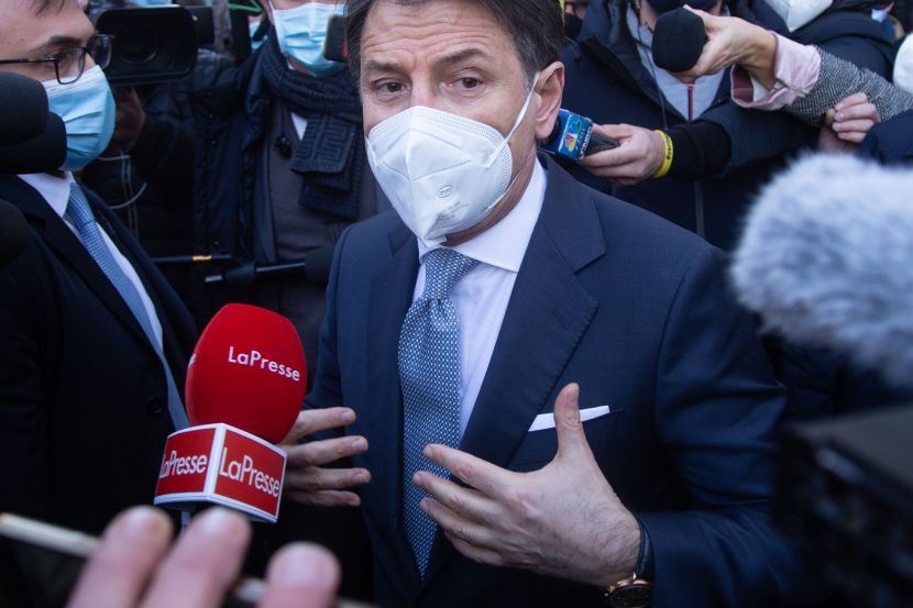 Giuseppe Conte speaks to journalists.