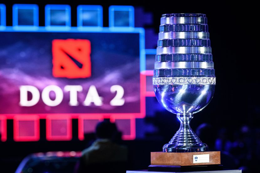 The ESL Trophy in front of the Dota 2 logo.