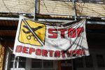 Banner against forced expulsion of foreigners, migrants, refugees.